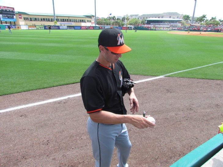 Marlins player signing autographs