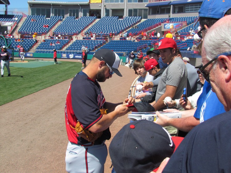 Evan Gattis signing autographs