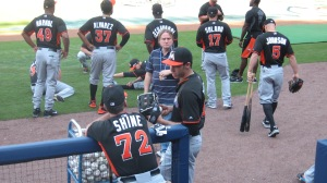 Marlins players outside dugout