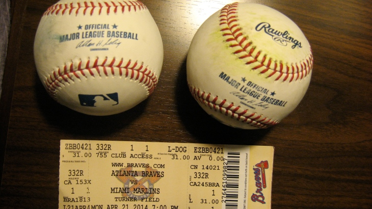 My two baseballs and a ticket I found