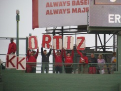 """The K-men on top of the Green Monster display """"ORTIZ"""" signs"""