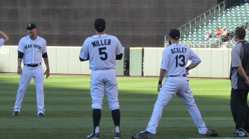 Brad Miller and Dustin Ackley before the game