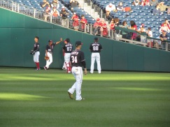 Harper running and stretching out pregame