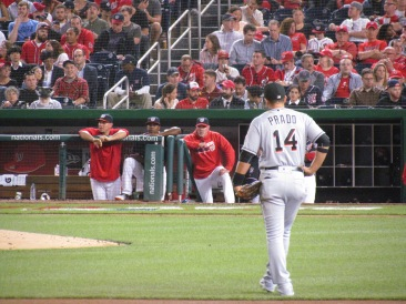 Martin Prado as the Nationals bench looks on