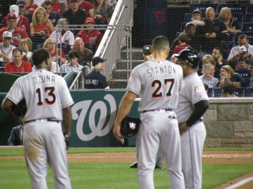 Stanton and Ozuna chat during a break in the game