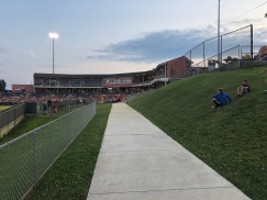 The grassy berm along the left field line